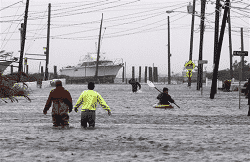 People wading in water from Storm Sandy